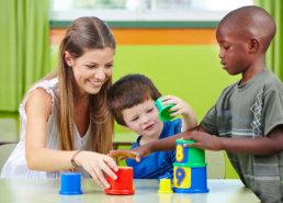 teacher and children playing